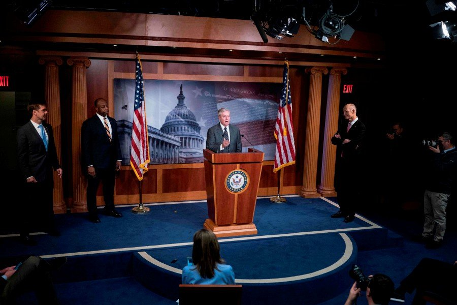 Senator Lindsey Graham speaks while flanked by (left-right) senators Tim Scott, Josh Hawley, and Rick Scott during a press conference at the US Capitol March 25, 2020, in Washington, DC. - AFP pic