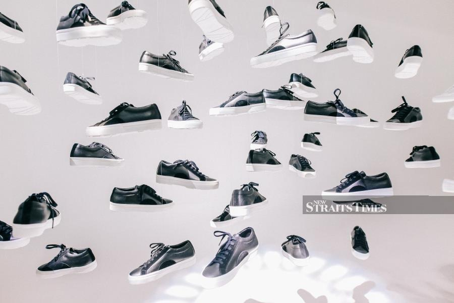 Sanctvs shoes in black suspended in the air, like an art installation, at the launch of the brand.
