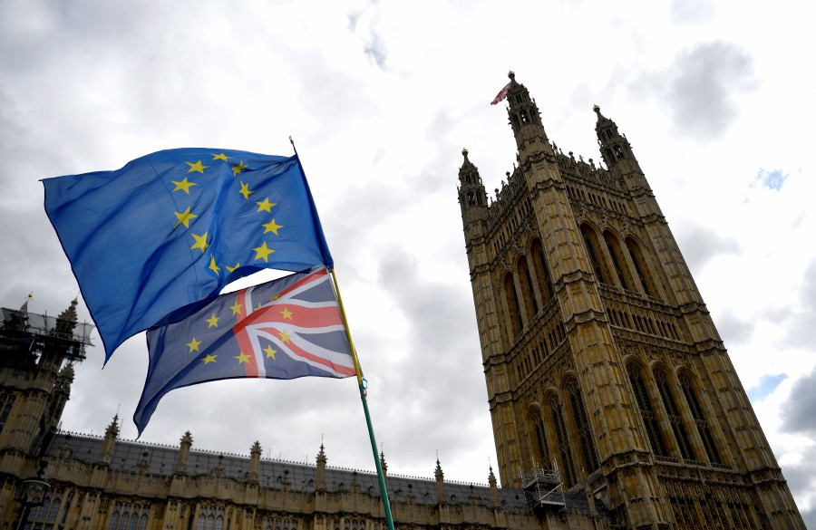EU flags fly during a demonstration outside the British Houses of Parliament in Westminster, central London, Britain. - EPA/File pic