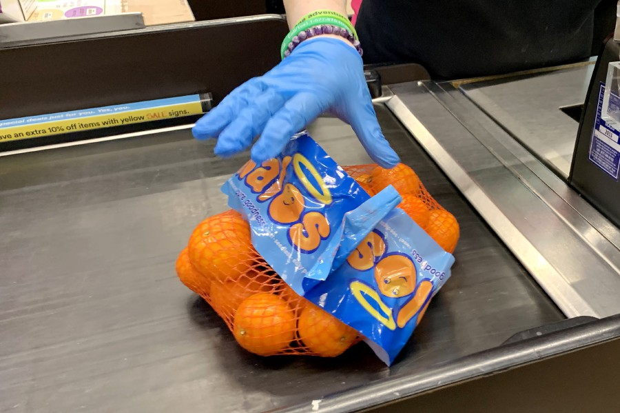 CAMBRIDGE, MASSACHUSETTS - MARCH 23: A cashier wears gloves at Whole Foods on March 23, 2020 in Cambridge, Massachusetts. Massachusetts The US Customs and Border Protection (CBP) on Tuesday said disposable rubber gloves made by WRP Asia Pacific Sdn Bhd after March 16, 2020, will be admissible at all US ports of entry. - AFP/file pic