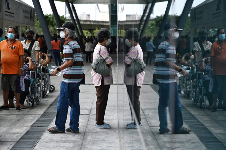 People including the elderly queue up for walk-in Covid-19 coronavirus vaccinations at Bang Sue Central Railway Station in Bangkok. - AFP Pic