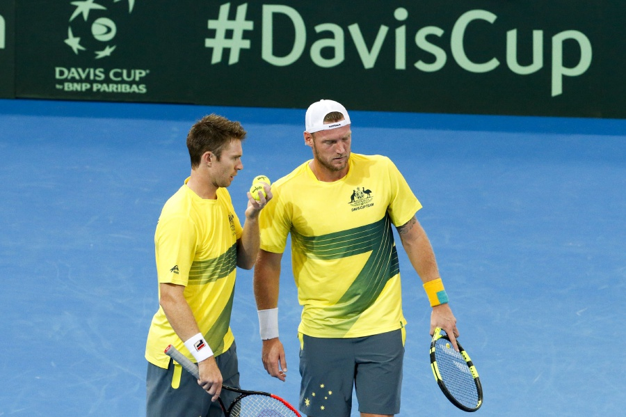 Sam Groth (right) and John Peers of Australia in action against Sam Querrey and Steve Johnson of the USA. EPA