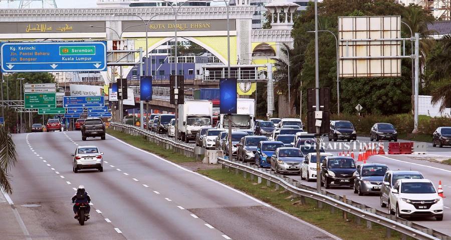 A traffic crawl in Kuala Lumpur on March 25, despite the Movement Control Order. - NSTP/SAIFULLIZAN TAMADI.