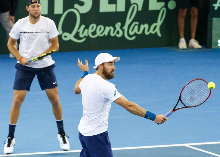 Steve Johnson (right) and Jack Sock of the USA in action against Sam Groth and John Peers of Australia during the Davis Cup World Group Quarterfinal match in Brisbane, Queensland. EPA