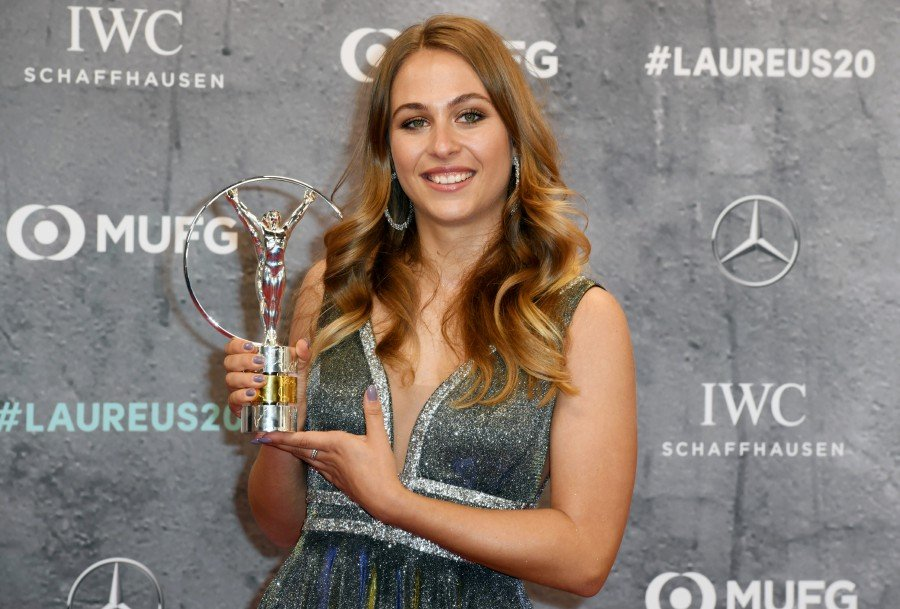 Sophia Florsch poses with the Laureus World Comeback of the Year award during the Laureus World Sports Awards 2020 in Berlin. -Reuters