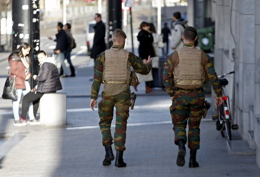 Belgian soldiers patrol in central Brussels following a probe on a planned terror attack during New Year's eve. REUTERS