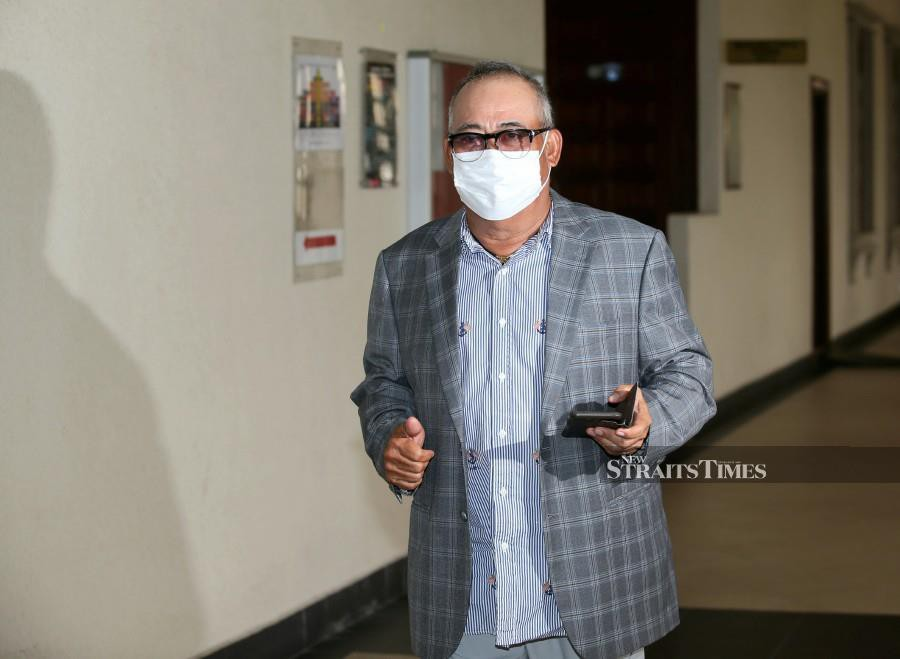 Witness, Saidi Abang Samsudin walks at the Kuala Lumpur Courts Complex before the start of the trial. -NSTP/EIZAIRI SHAMSUDIN