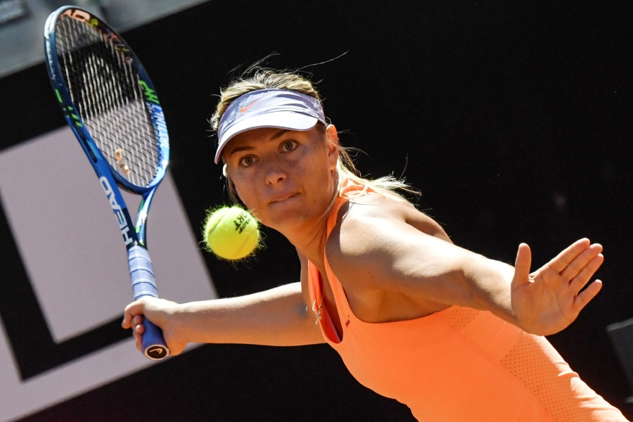 Maria Sharapova confirms withdrawing from the Wimbledon Open after failing to recover from a thigh injury. AFP