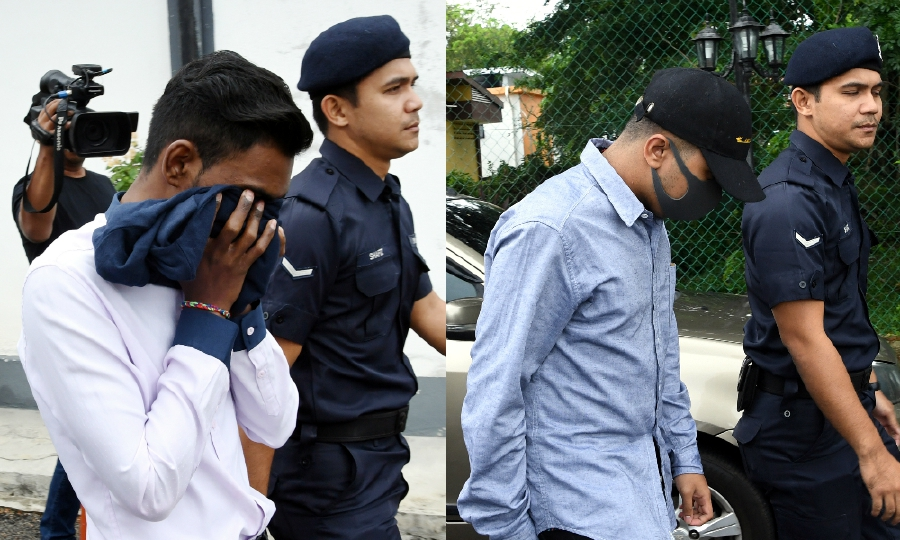 B. Thayalan (left) and Nabil Hariz Jefridin are led by policemen ahead of their trial at the Rembau Magistrate's Court. - Bernama