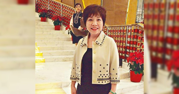 Hong Kong's richest woman sees her wealth halved