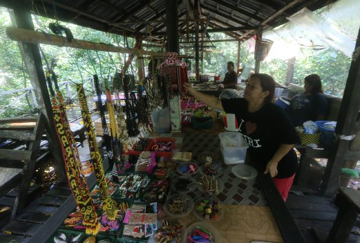 Sunta Jok is just one of the traders selling souvenirs at Niah cave. Pix by YAZIT RAZALI