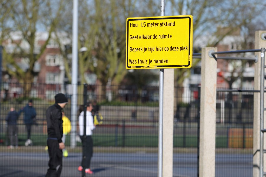 A photograph taken on March 22, 2020 shows a panel of Rotterdam's municipality indicating protective measures to adopt on a sports field as part of the measure taken by the Dutch government to fight against the spread of the COVID-19 outbreak (the novel coronavirus). - AFP pic
