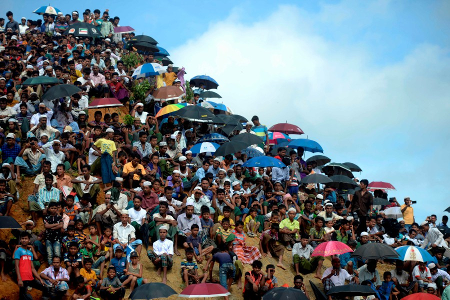 Rohingya refugees attend a ceremony organised to remember the second anniversary of a military crackdown that prompted a massive exodus of people from Myanmar to Bangladesh, at the Kutupalong refugee camp in Ukhia on August 25, 2019. - AFP/file pic