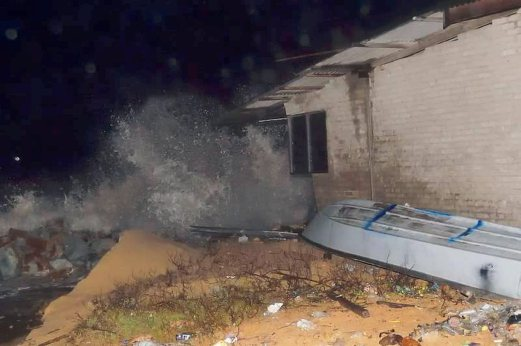 Several houses were damaged after high waves lashed Kampung Tanjung Gelam, Mengabang Telipot. Pix by MOHD SYAFIQ AMBAK.