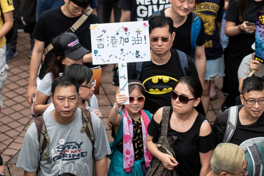 People attend a march in Tseung Kwan O district in Hong Kong on August 4, 2019, in the latest opposition to a planned extradition law that has evolved into a wider movement for democratic reforms. — AFP