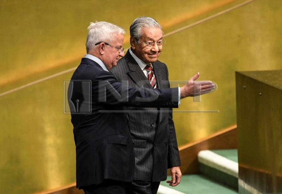 Malaysia's Prime Minister Tun Dr Mahathir Mohamad arrives to speak during the General Debate of the 73rd session of the General Assembly at the United Nations in New York on September 28, 2018. AFP