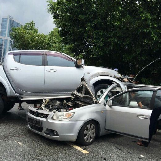 Woman killed after Proton Saga is crushed by Mitsubishi ...
