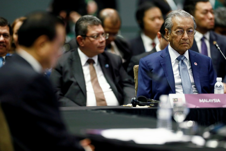 (File pix) Prime Minister Tun Dr Mahathir Mohamad during a meeting at the ASEAN summit. Reuters