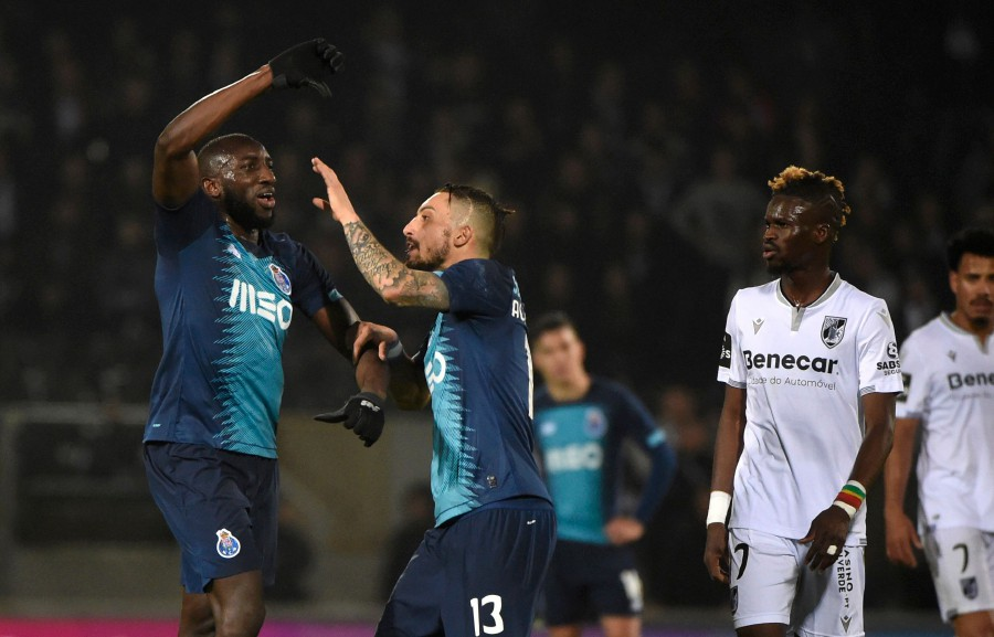 Porto's Malian forward Moussa Marega (left) reacts and attempts to leave the pitch after hearing racists chants as teammate Alex Telles tries to stop him during the match against Vitoria Guimaraes at the Dom Alfonso Henriques stadium in Guimaraes. -AFP