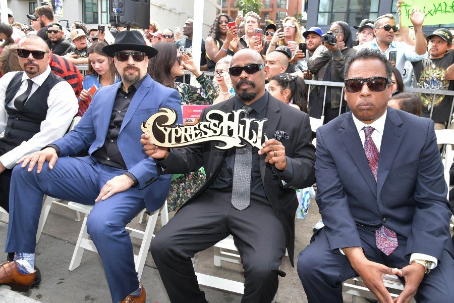 """Member of the hip-hop group Cypress Hill Lawrence """"DJ Muggs"""" Muggerud, Louis """"B-Real"""" Freese, Senen """"Sen Dog"""" Reyes and Eric """"Bobo"""" Correa are honoured with star on The Hollywood Walk of Fame on April 18, 2019 in Hollywood, California. --AFP"""