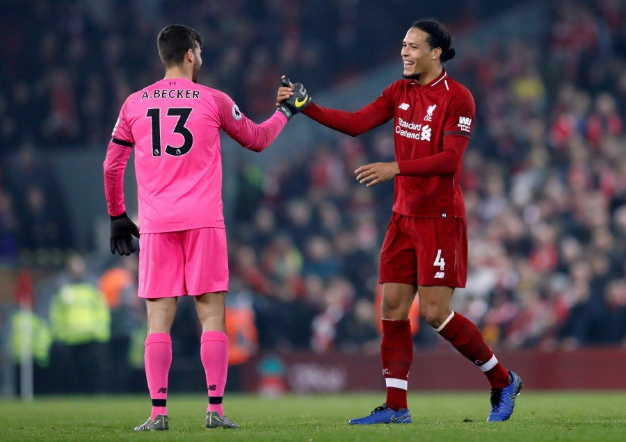 fa674579a Liverpool s Virgil van Dijk and Alisson celebrate after the match against  Watford. Van Dijk scored two goals in the 5-0 victory on Feb 27 at Anfield.