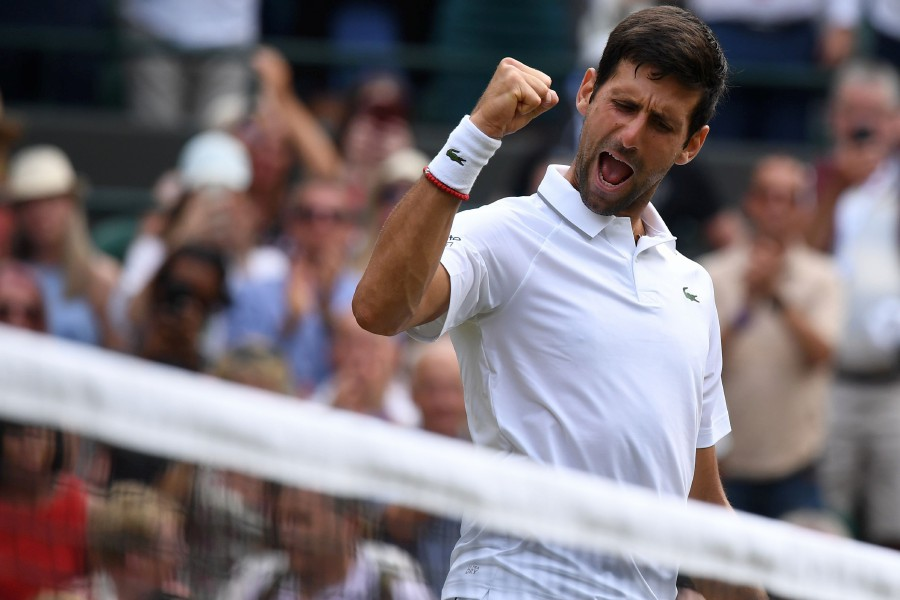 Serbia's Novak Djokovic celebrates after beating Poland's Hubert Hurkacz during their men's singles third round match on the fifth day of the 2019 Wimbledon Championships at The All England Lawn Tennis Club in Wimbledon, southwest London. - AFP