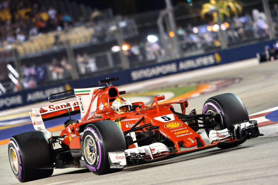Formula One: Hamilton profits from Vettel crash to win Singapore Grand Prix