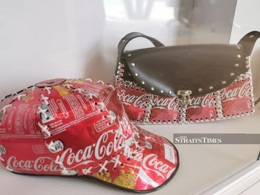 A unique cap and handbag made out of Coca-Cola cans on display in Perlis.