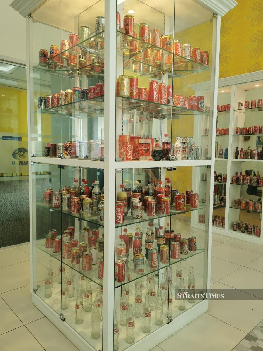 Some of Tuanku Syed Faizuddin Putra's collection carefully displayed in glass shelves.