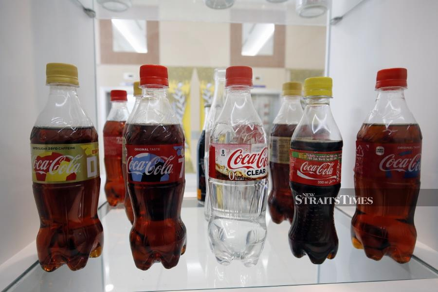 Tuanku Syed Faizuddin Putra usually collects unopened bottles and cans of Coke. Seen here is the rare Coca Cola Clear (in the centre).