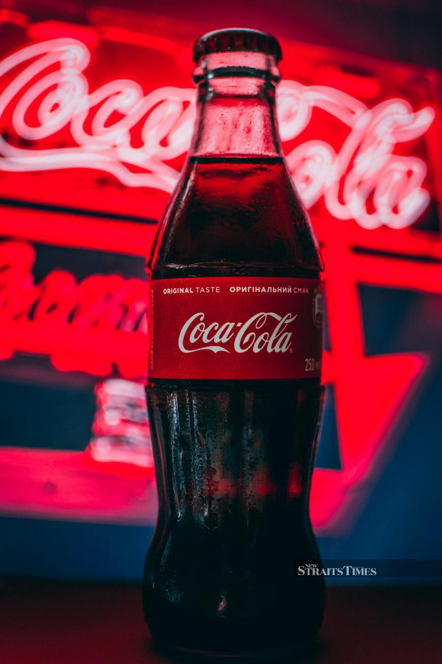 The Coca-Cola distinctive logo can be spotted everywhere.