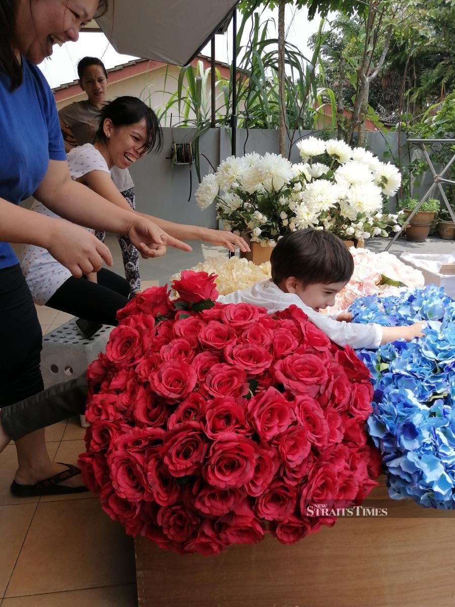 Mohana's grandson Ari loved having all these flowers around.