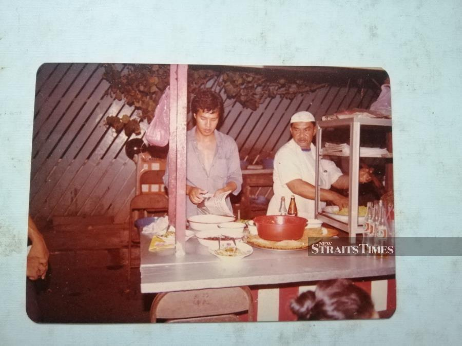 Shafiq's late grandfather seen here at his Mee Rebus stall.