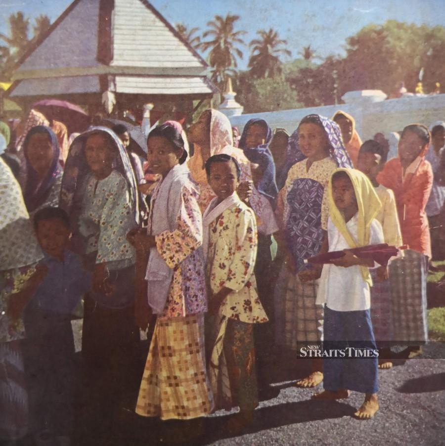 Malay women dressed to the nines attending a festival in the late 1940s.