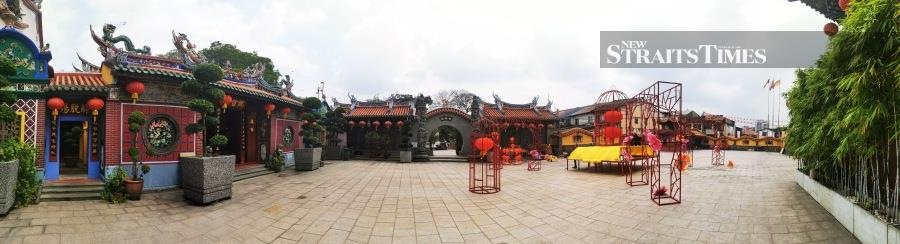 The old Kwan Yin temple on the left in a large courtyard.