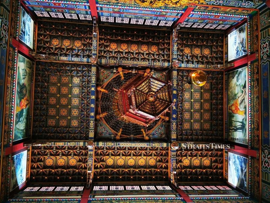 The ornate ceiling of the main temple hall.