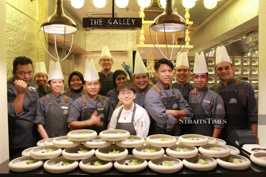 Goh and part of her 15-man crew who were behind the Taste, Texture and Theatre dinner at The St Regis Langkawi.