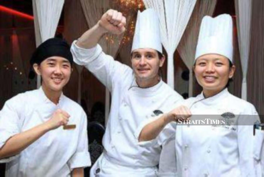 """Chefs Mandy Goh, Marcel Kofler and See Lay Na at the Bocuse d""""Or Asia in Shanghai 2010."""