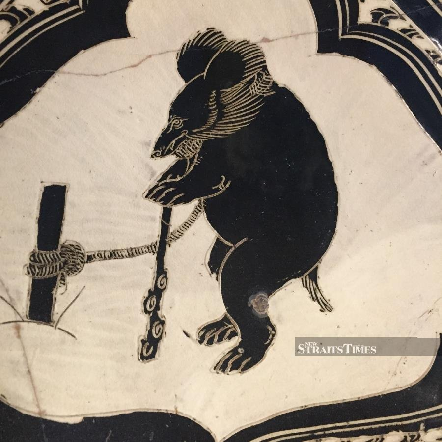 Although this ancient Chinese pillow is in black and white, the bear being baited is, again, not a panda.