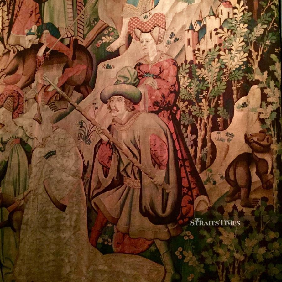 Bear hunting was a popular pursuit in the European Middle Ages. An orphaned cub makes a sad sight to the right of this 15th century Dutch tapestry.