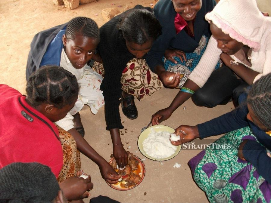 In much of Zambia, eating together is an important part of building relationships.