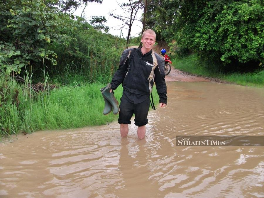 Wading through a flooded road in Zambia.