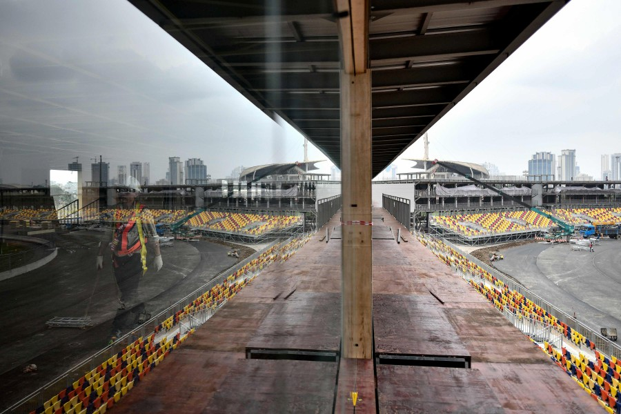 In this file photo taken on Feb 14, 2020, a worker walks past in the under-construction Formula One Vietnam Grand Prix race track site in Hanoi, amid concerns of the Covid-19 coronavirus outbreak. (AFP)