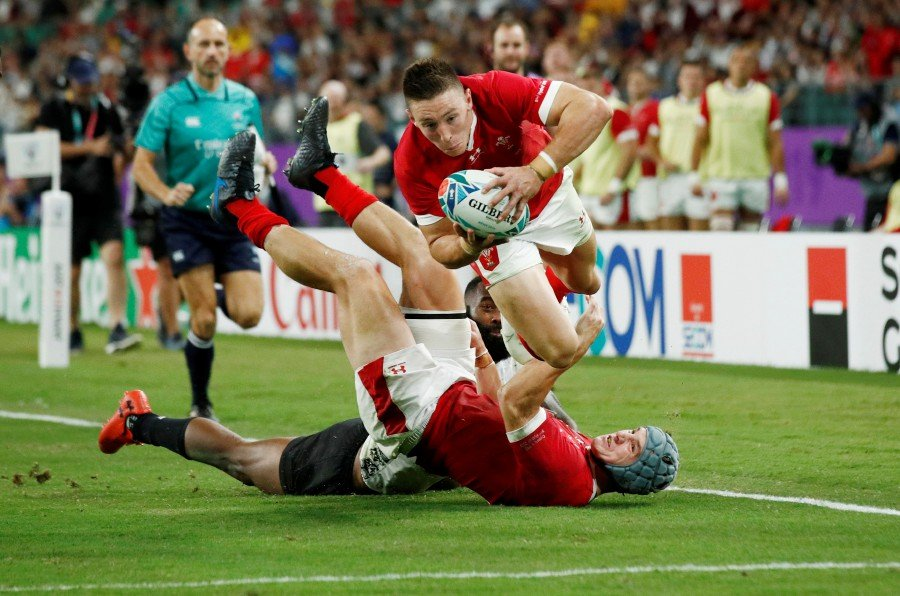 Wales' Josh Adams scores their third try. - Reuters