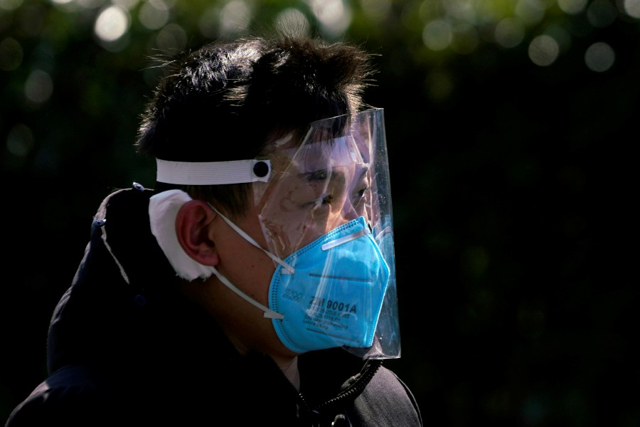 A man wears a face mask as a protection from coronavirus in Shanghai, China. -Reuters