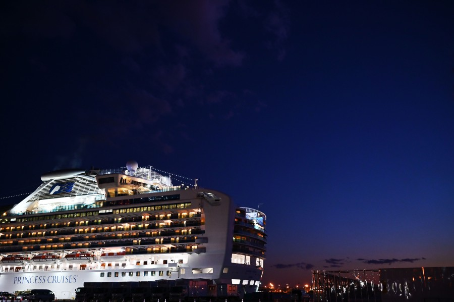 The Diamond Princess cruise ship is pictured at dusk at the Daikoku Pier Cruise Terminal in Yokohama port. (AFP)