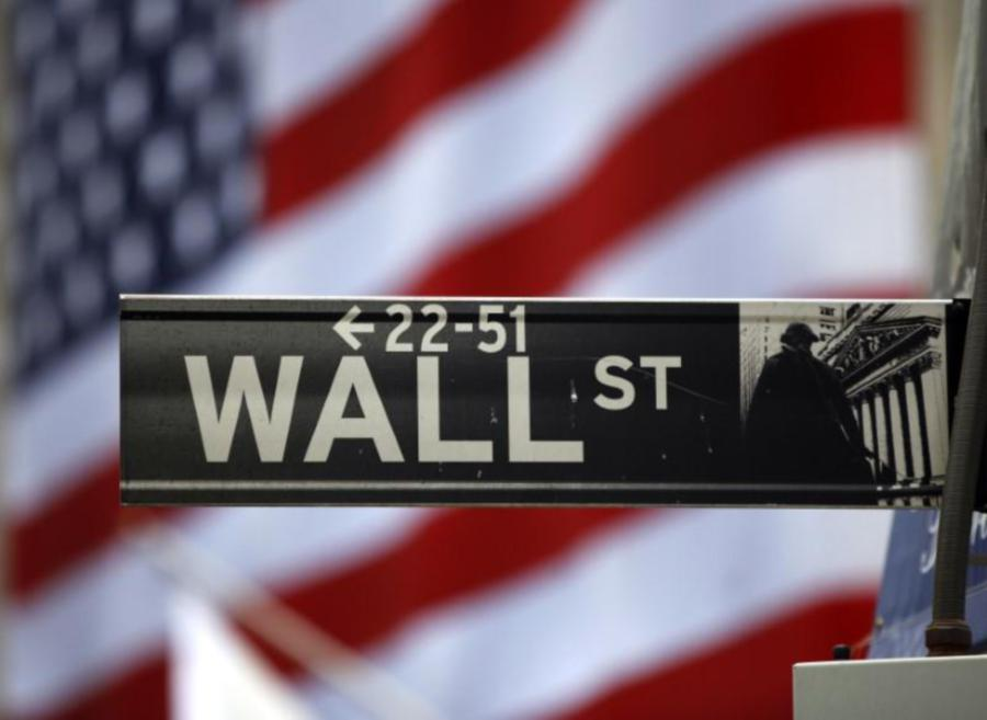 The Wall Street sign is seen outside the New York Stock Exchange, March 26, 2009. REUTERS