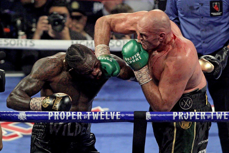 British boxer Tyson Fury (right) slams a right to the head of US boxer Deontay Wilder during their World Boxing Council (WBC) Heavyweight Championship Title boxing match at the MGM Grand Garden Arena in Las Vegas on February 22. -AFP