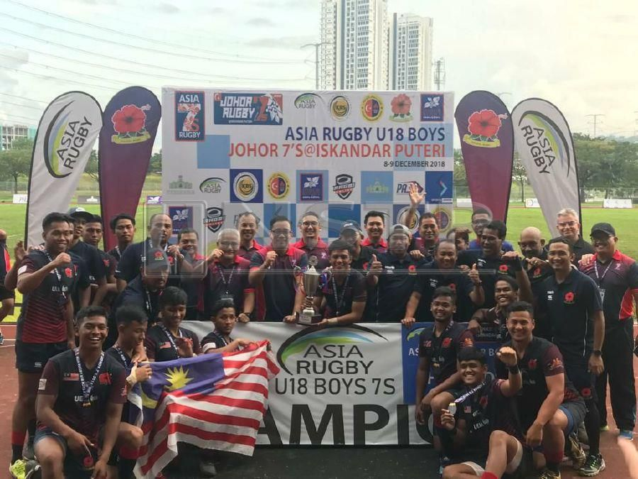 Malaysian rugby team celebrate after winning the Asia Rugby Under-18 Championship in Johor Baru.