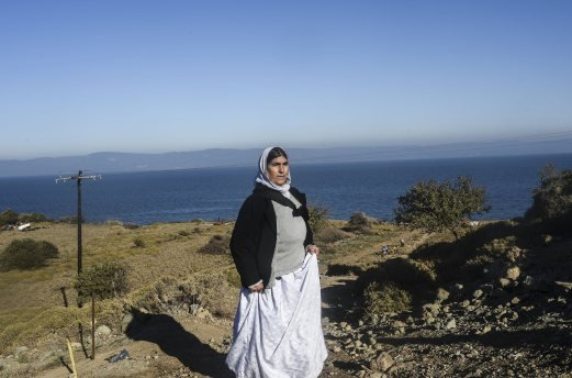 A displaced Iraqi woman from the Yazidi community, who fled violence from Islamic State (IS) group jihadists, walk after their arrival on the Greek island of Lesbos after crossing the Aegean Sea from Turkey. A mass grave believed to hold the remains of dozens of Yazidi women executed by the Islamic State group was found in northern Iraq. AFP photo